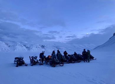 Tour-group with snowmobiles
