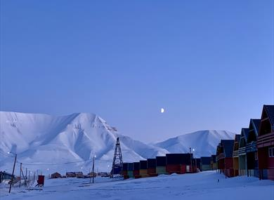 The moon shining over Longyearbyen