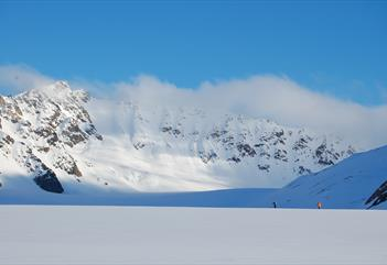 Skiers in a mountainous landscape