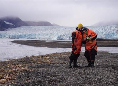 Two guests with a glacier in the background