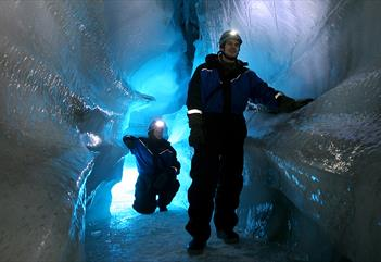 Two people in an ice cave